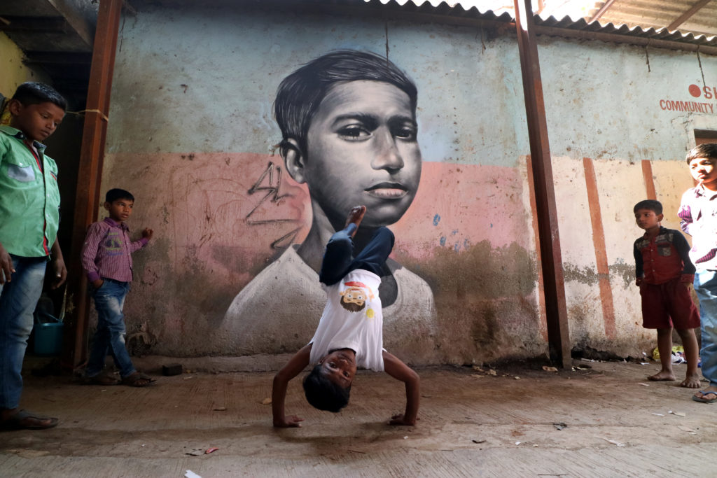 Shiva Aka Bboy Prokid from #SlumGods crew. Shiva is 12 years old and has been bboying for the past 3 years. I was blown away by his style, and his passion reminded me of myself when I was this age. Shiva is one of many students from the workshops facilitated by @nme_graffiti_india in Dharavi. Dhavari was founded in 1882 during the British colonial era and is home to over 700,000 people, making it the third largest slum in the world.